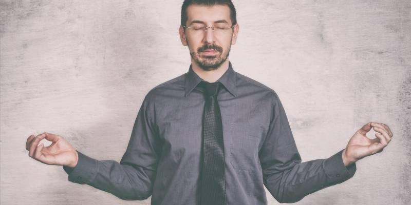 a man meditating at work